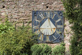 Old sundial on a brick wall — Stock Photo