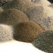 Various brown toned sand piles together — Stock Photo