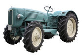 Nostalgic tractor in white back — Stockfoto