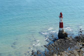 Lighthouse near Beachy Head at summer time — Stock Photo