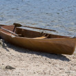 Stock Photo: Wooden rowboat waterside