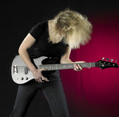 Playing bass guitar — Stock Photo