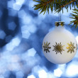 White Christmas bauble in blue back — Stock Photo #7224773