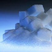 Blue illuminated lump sugar pile — Stock Photo