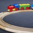 Colorful wooden toy train on tracks — Stock Photo