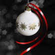 Stock Photo: White Christmas bauble in dark back