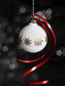 White Christmas bauble in dark back — Stock Photo