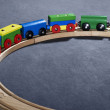 Colorful wooden toy train on tracks — Stock Photo #7297752