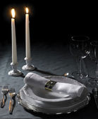 Festive place setting and candlelight — Stok fotoğraf