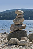 Waterside scenery with pebble pile — Stock Photo