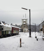 Old railway cars and station — Stock Photo