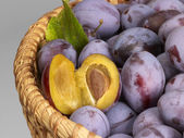 Plums in a basket — Stock Photo