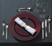 Noble place setting on dark tablecloth — Stock Photo