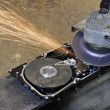 Stock Photo: Hard disk grinding