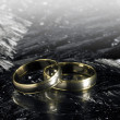 Two golden wedding rings on ice surface — Stock Photo #7396914