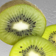 Fresh sliced kiwi fruits - Stock Photo