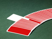 Playing cards in a row — Stock Photo