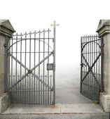 Open wrought-iron gate — Stock Photo