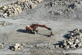 Resting quarry digger and stones — Stock Photo
