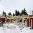 Wooden house construction at winter time — Stok fotoğraf