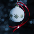 Christmas bauble with red bow — Stock Photo
