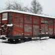 Old railway car at winter time — Stock Photo