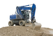 Blue digger on earth pile — Stock Photo