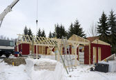 Wooden house construction at winter time — Stock Photo