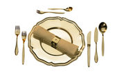 Golden place setting — Stock Photo