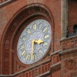 Clock at the Red Town Hall - Stock Photo