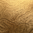 Stock Photo: Abstract snake pattern in sand