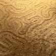 Abstract snake pattern in the sand — Stock Photo