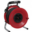 Red plastic cable reel — Stock Photo