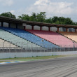 Tribune opposite pit lane - Stock Photo