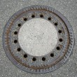 Stock Photo: Round manhole cover