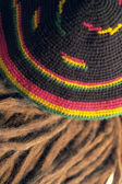 Rasta cap and dreadlocks — Stock Photo