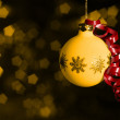 Christmas bauble in blurry back — Stock Photo