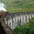 Glenfinnan Viaduct and steam train - Stock Photo