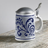 Blue decorated stein on wooden surface — Stock Photo