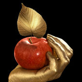 Golden hand and apple — Stock Photo