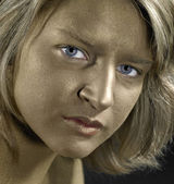 Golden face of a young woman — Stock Photo
