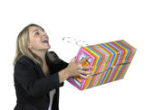 Blonde girl recieving a present — Stock Photo