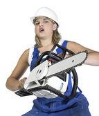 Pushy chain saw girl — Stock Photo