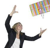 Blond girl is throwing a present — Stock Photo