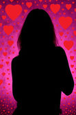 Girl silhouette with hearts — Stock Photo