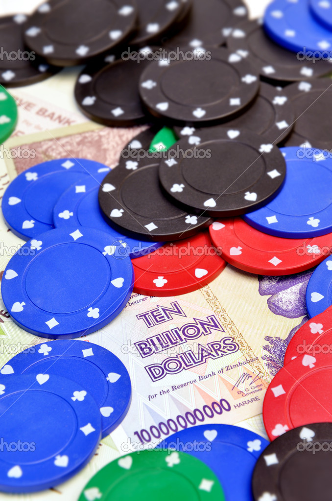 Photo of casino chips laying on ten billion dollars banknote — Stock Photo #6935588