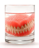 Dentures in the glass — Stock Photo