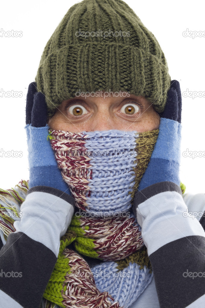 Girl with gloves, hat and scarf with beautiful eyes shocked — Stock Photo #7227293