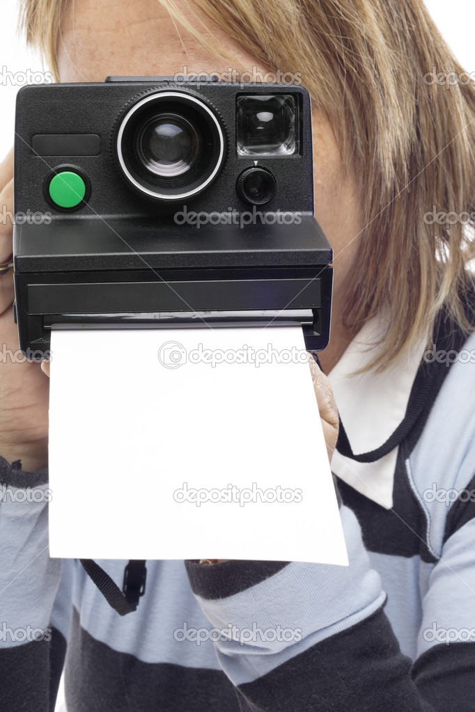 Woman holding an old camera where you leave a photo in white  Stock Photo #7227660