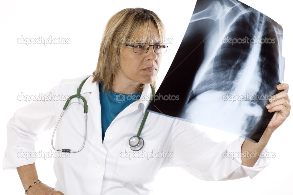 Young doctor looking at an x-ray of lungs on a white background — Stock Photo #7443017